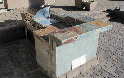 barbecue image: stainless steel barbecue with raised bar top and slate tile